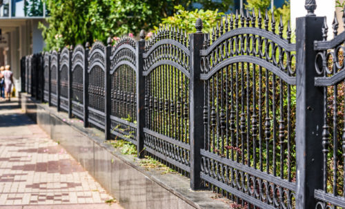 iron fence at the side of the street