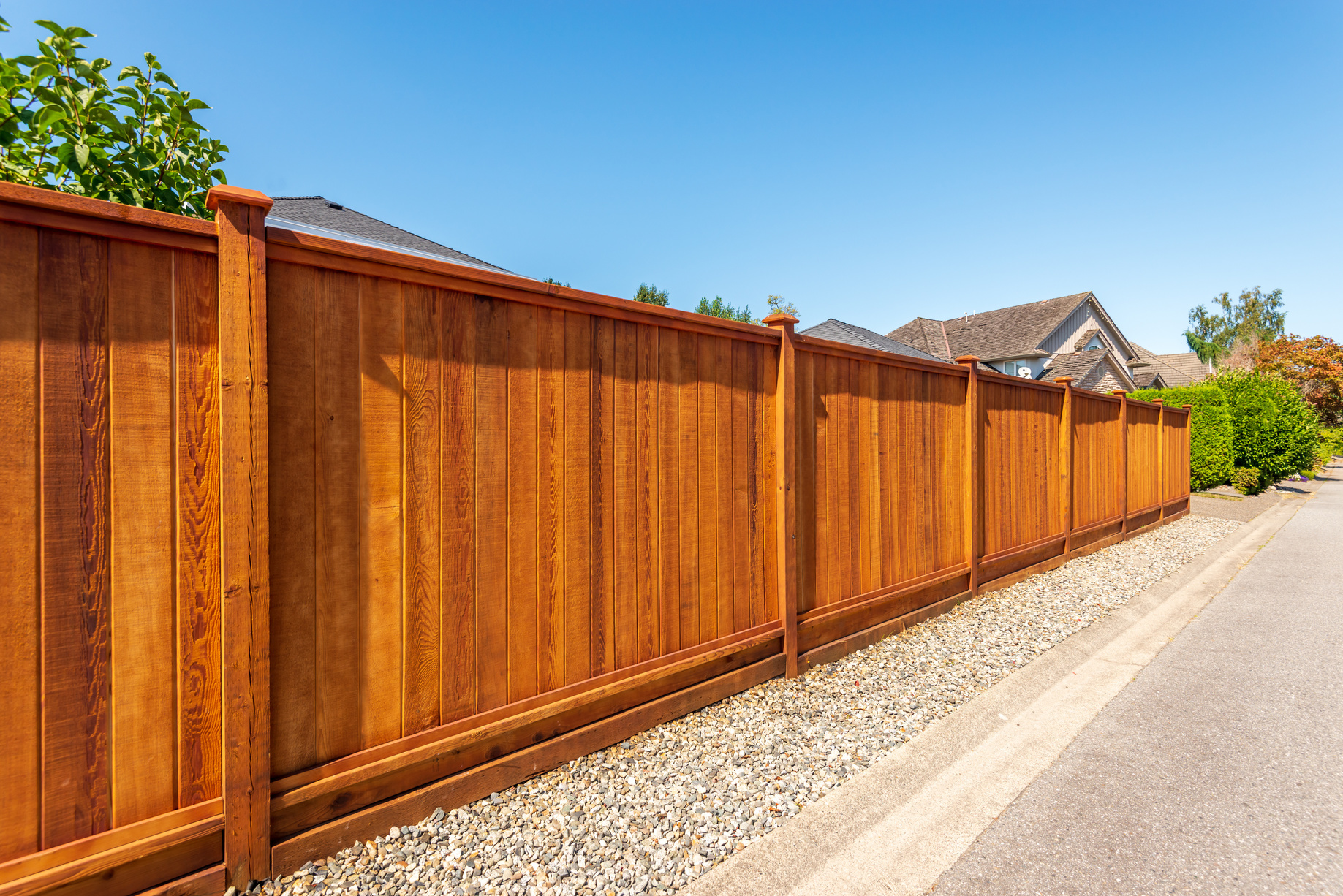 wood fence on the side of the road
