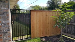 wood fence with wrought iron gate in sugar land