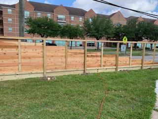 wood fence being installed in houston