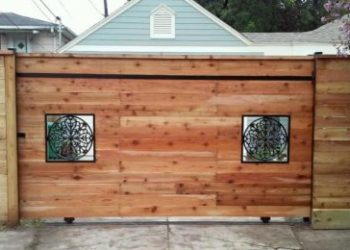 wood fence with iron window cutouts in houston