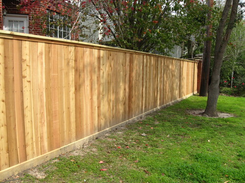 wood fence next to a home
