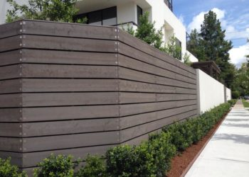 wood fence next to a commercial building