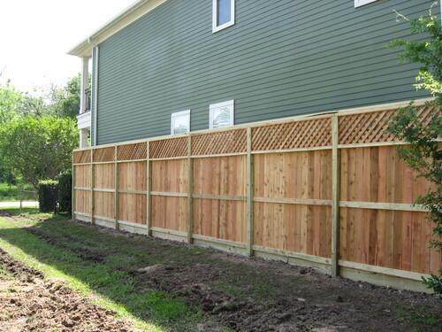 wood fence near a conroe home