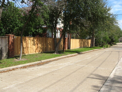 wood fence in a gated conroe community