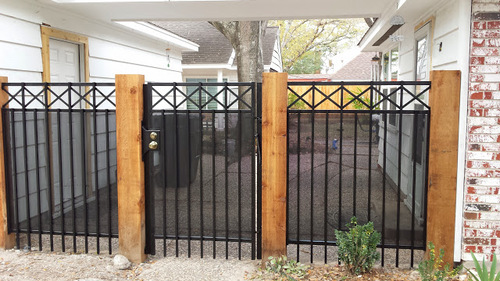 wood & wrought iron fence in the woodlands