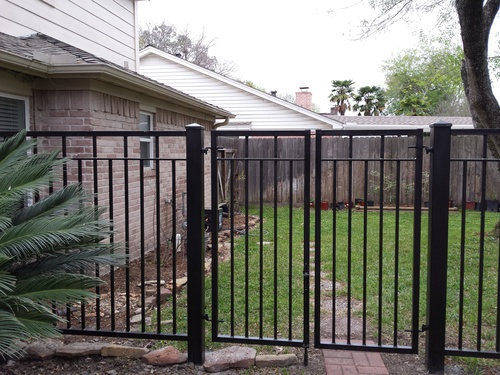 wrought iron fence in the woodlands