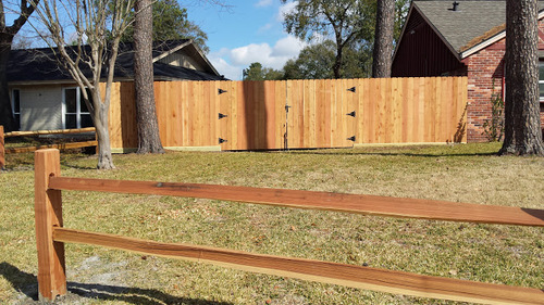 wooden fence next to a conroe home