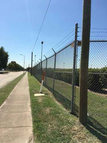 chain link fence on the side of the road