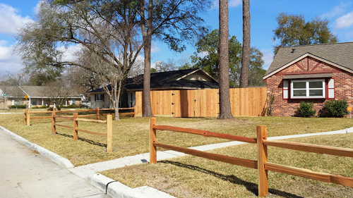 wood fence next to a home in the woodlands