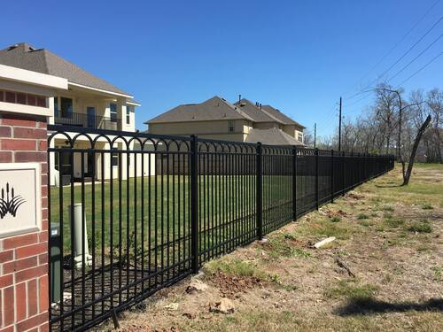 wrought iron fence in a house community in the woodlands