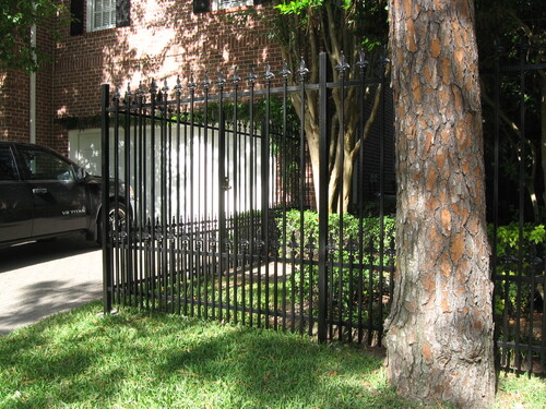 wrought iron fence in front of a katy home