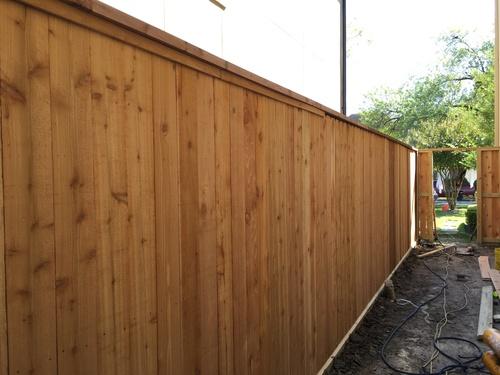 wood fence on a conroe property