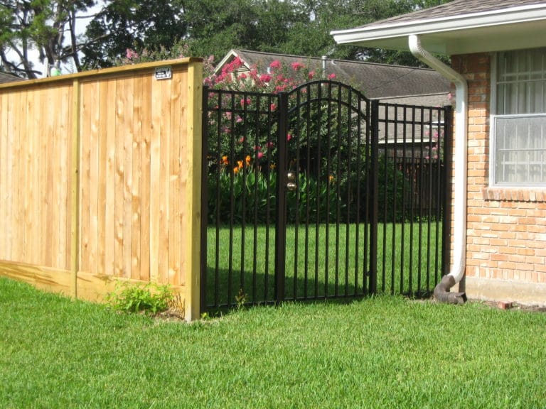 wood fence & wrought iron spring