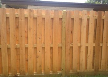 wood fence at a house